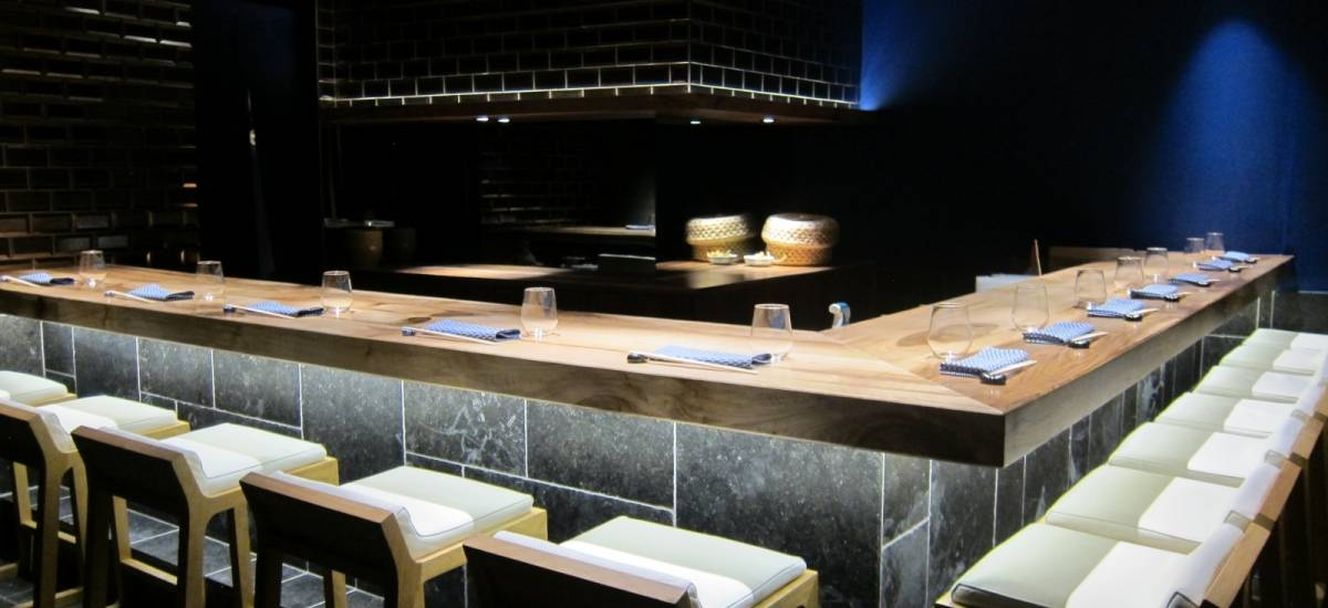 The thick French walnut counter in the Jin restaurant, designed by the Japanese architect Jun Yonekawa