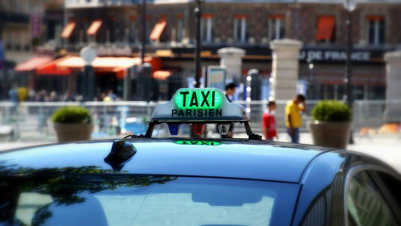 Taxi is free if its light is on (green or white)
